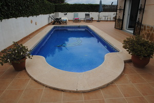 A 3 bed 2 bath villa, landscaped garden, private and close to amenities